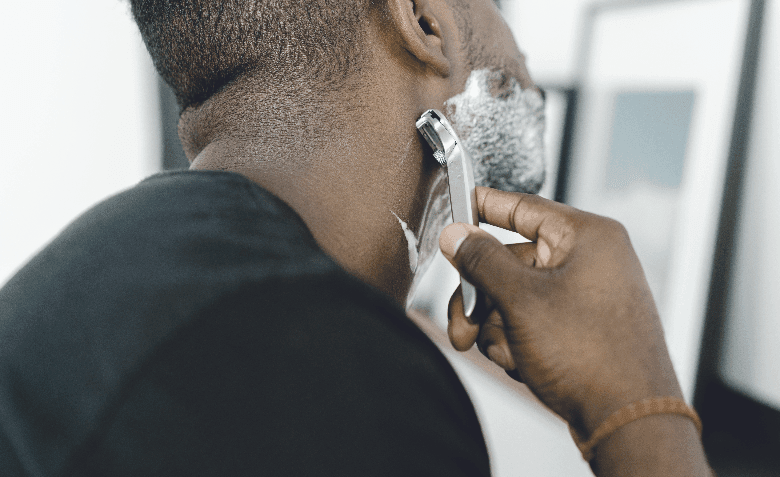 Man shaving with a razor