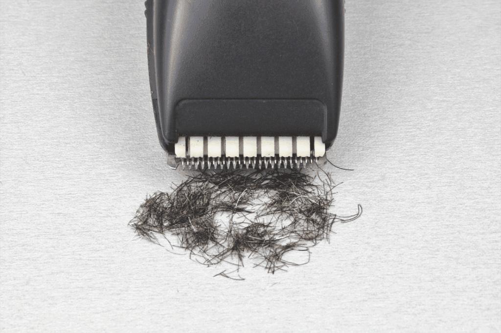 Hair clipper tip with cut hair underneath