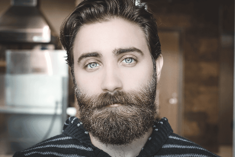Well groomed man with beard and blue eyes