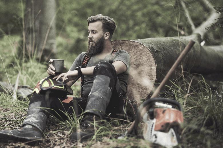 Lumber jack with long beard sitting down