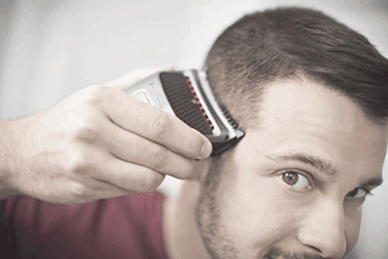 Man using a head shaver