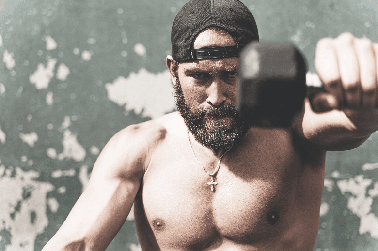 Bearded man working out outside