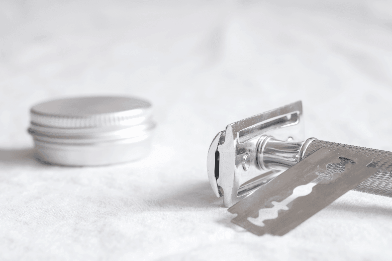 Double edge razor with cream and new razor blade