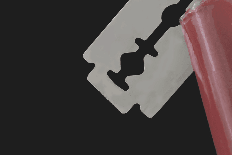 razor blade stuck in red object