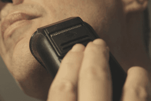 Man using foil shaver