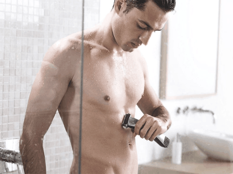 Man using Philips Norelco Bodygroom 7100 in a shower