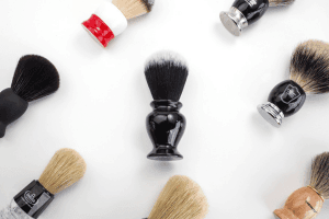 Shaving brushes laid out on white background