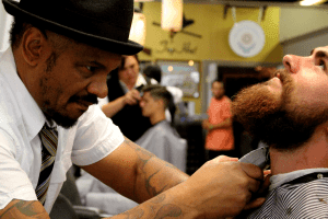 Barber trimming a customers beard