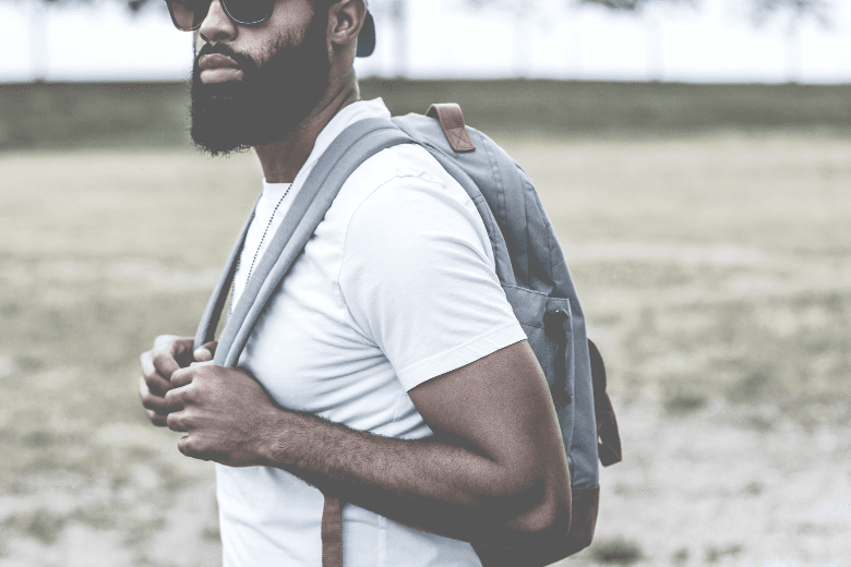 Man with backpack and full beard