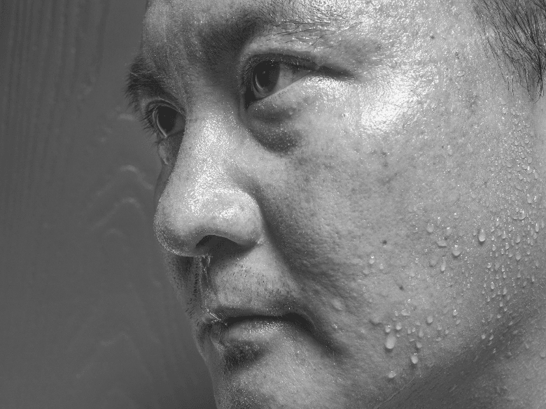 Image of Man sweating and looking to the side