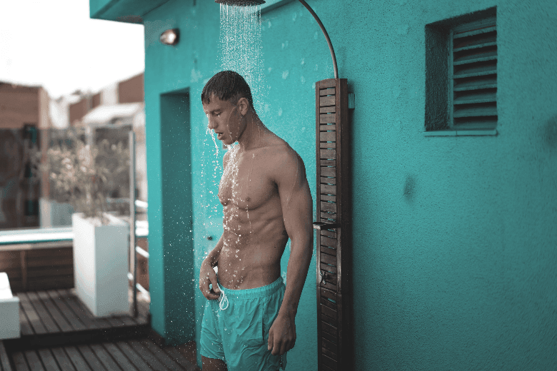 Man showering outside at a holiday home