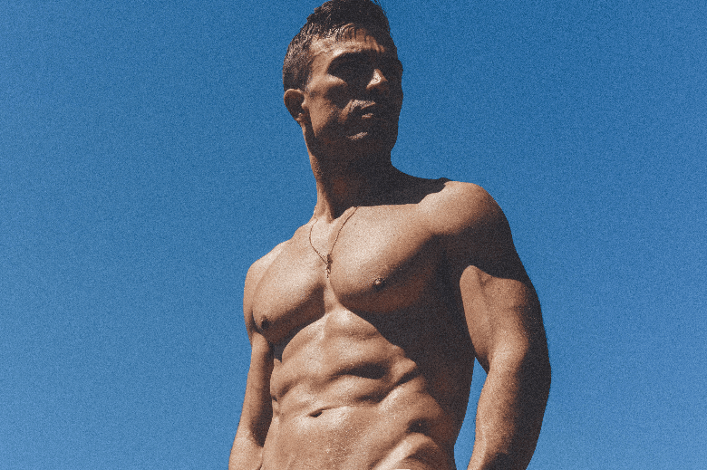 Clean shaven body man on blue background looking into the distance