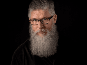 Man with glasses and a long grey beard