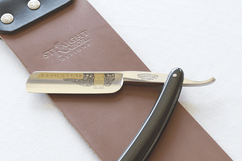 Straight razor on a leather belt