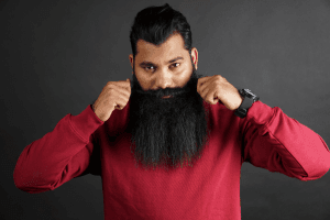 man in red shirt and long black beard