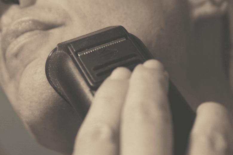 Man using foil shaver on face