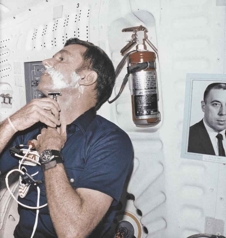 Astronaut shaving in zero g