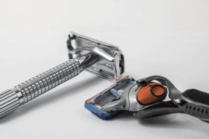 Double edge razor and cartridge razor on white surface