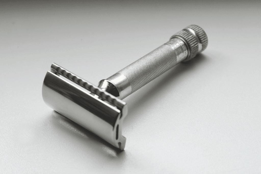 double edge razor laying on table