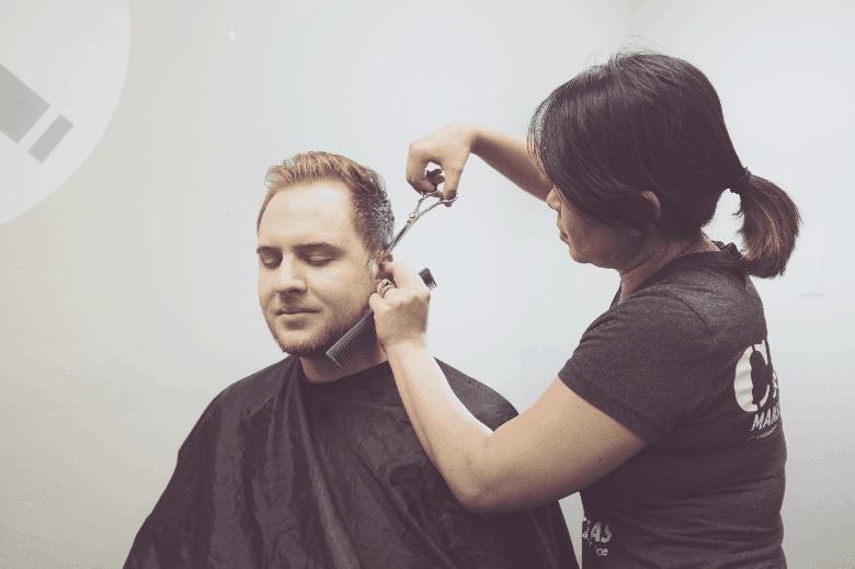 Man receiving a professional haircut
