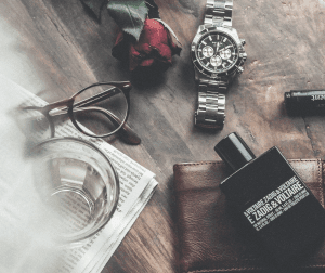 mens fashion accessories on a wooden table
